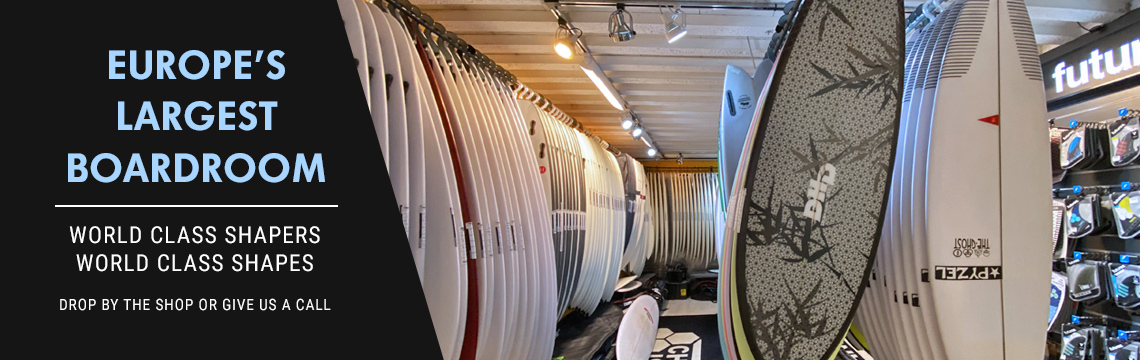 A large room containing hundreds of surfboards