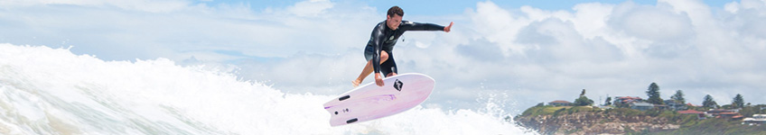 A man surfing a softboard