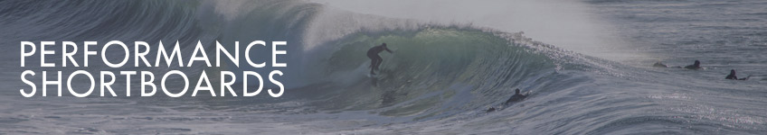 A surfer riding a large barreling wave